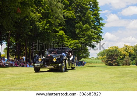 PLYMOUTH - JULY 26: The best in show foreign award winning Bugatti  on display July 26, 2015 at the Councors D'Elegance in Plymouth, Michigan. - stock photo