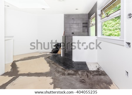 Plywood subfloor, seams covered with floor filler, in preparation for laying cork tiles - stock photo