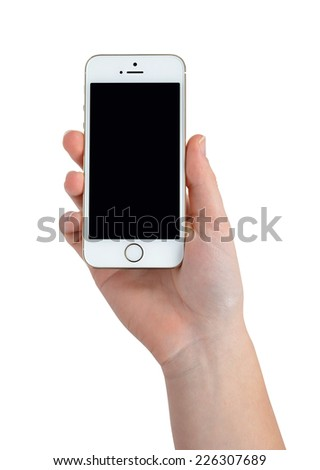 Plzen,Czech Republic - October 11, 2014 : Woman Hand Holding Apple iPhone 5S Smart Phone - stock photo