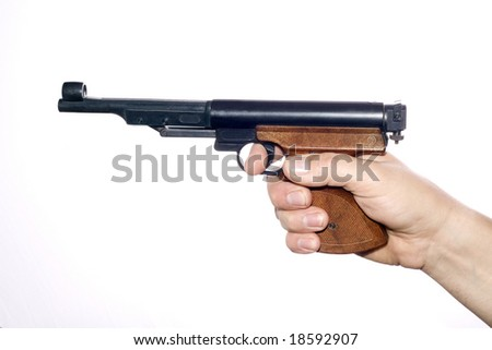 Pneumatic pistol in hand over white
