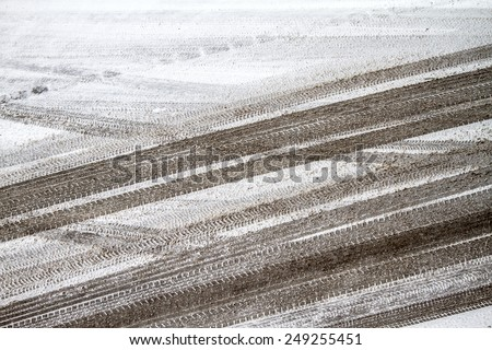 Pneumatic trace on a snowy road  - stock photo