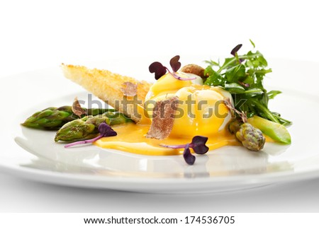 Poached Egg with Asparagus and Crispy Bread - stock photo
