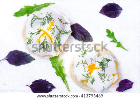 Poached eggs at eggburgers, rustic style - stock photo