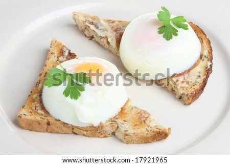 Poached eggs on toast - stock photo