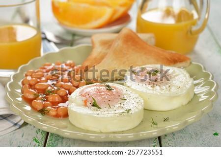 Poached eggs on white background - stock photo