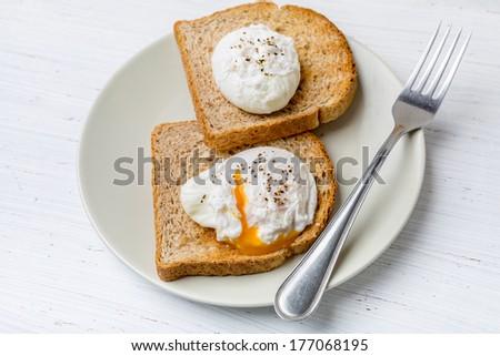 Poached Eggs on  Wholegrain Bread Toasts - stock photo