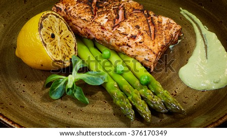 Poached eggs with salmon and rasparagus - stock photo