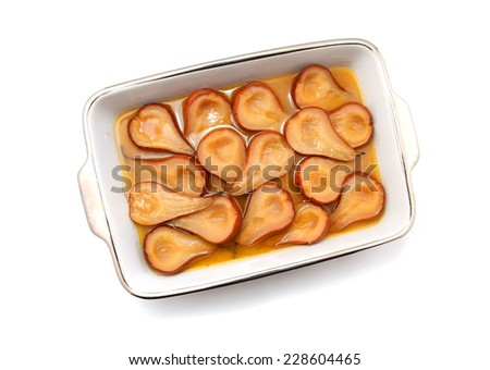 Poached Pear or Pear Dessert in a dish isolated on white  - stock photo