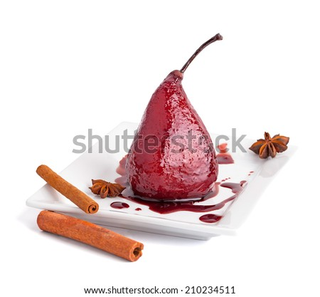 Poached pears in syrop with cinnamon isolated on white - stock photo