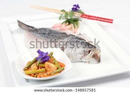 Poached sea bass - stock photo