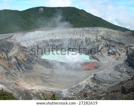 Poas Volcano Crater with misty sulfur clouds, in national park in Costa Rica - stock photo