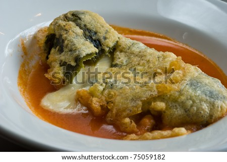 poblano pepper stuffed with cheese and fried - stock photo