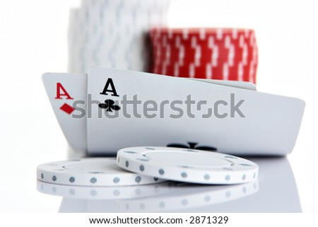Pocket Aces and poker chips - stock photo