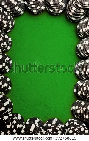 Pocket aces on red felt with black chips