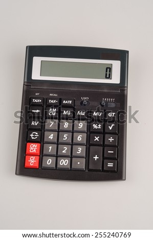 pocket calculator on a white background ready to be used - stock photo