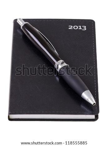 Pocket calendar with pen - stock photo