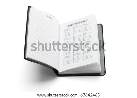 Pocket diary showing 2011 calendar on white background