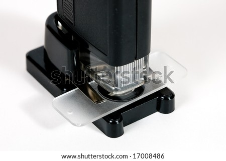 Pocket microscope on white background
