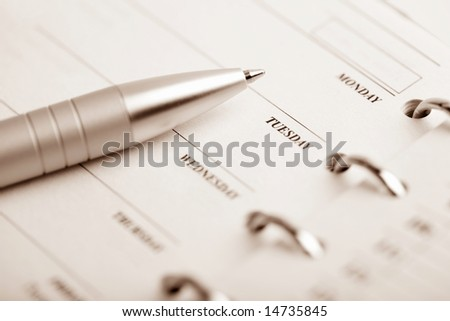 pocket organizer and pen - stock photo
