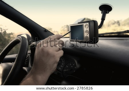 Pocket PC with GPS module attached to the windscreen. - stock photo