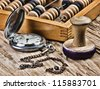 pocket watch, abacus and stamp on a wooden table - stock photo