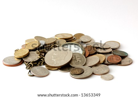 Pocket watch among coins isolated on white