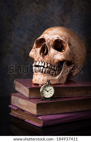 Pocket  watch and human skull ,concept and idea - stock photo