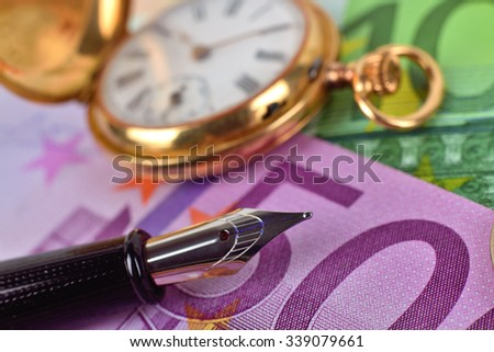 pocket watch, euro bills and ink pen, extra close up - stock photo