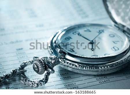 Pocket watch financial report  - stock photo