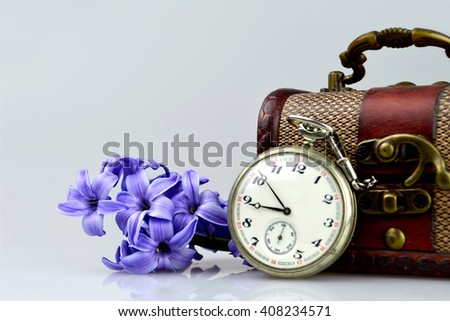 Pocket watch, flowers and treasure chest - stock photo