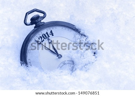 Pocket watch in snow, New Year 2014 greeting card - stock photo