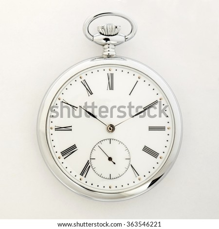 Pocket watch, Old style marks the passage of time in the foreground - stock photo