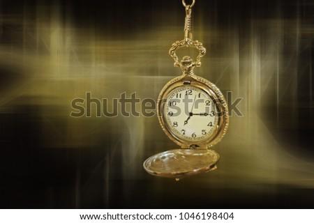stock-photo-pocket-watch-on-a-fractal-ba