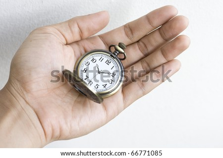 Pocket watch on hand