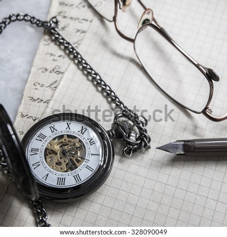 Pocket watch on old paper background, close up - stock photo