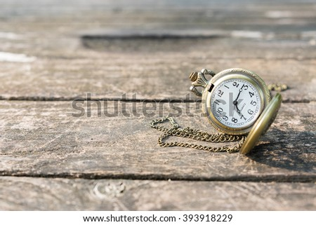 Pocket watch on old wood - stock photo