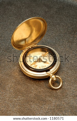 Pocket watch style old compass - stock photo