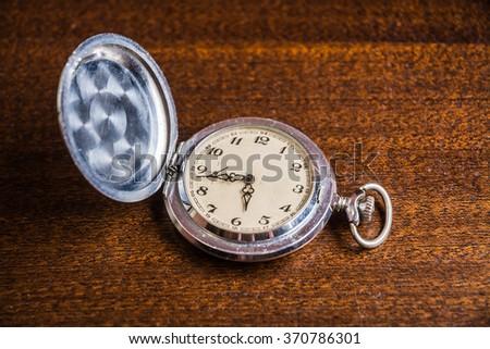 pocket watch. vintage artifact - stock photo