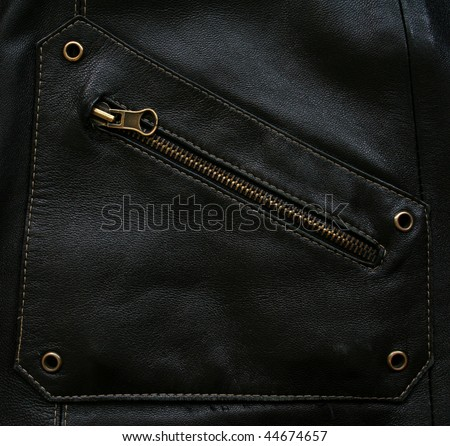 Pocket with zipper on the black leather texture as background - stock photo