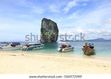 Poda Island Krabi Thailand : October 31 2016, Beautiful scenery at Poda Island Thailand with modern and traditional boats and big rock as background