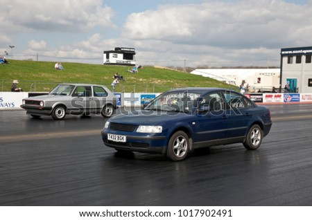PODINGTON, UK - APRIL 11: An unnamed driver takes his modified Volkswagen Golf VR6 automobile for a timed run down the Santa Pod raceway at the Big Bang festival on April 11, 2014 in Podington