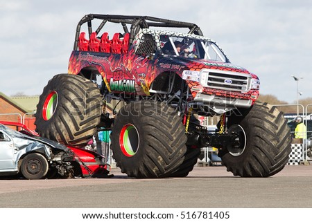 PODINGTON, UK - FEBRUARY 22: Monster truck 'Red Dragon' gives demonstration rides to the paying public at the annual Stuntfest event on February 22, 2014 in Podington