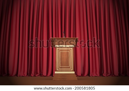 Podium and microphone in the center of the theatrical stage - stock photo