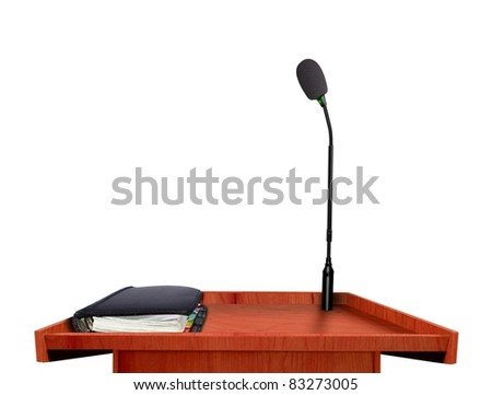 Podium microphone and note book - stock photo