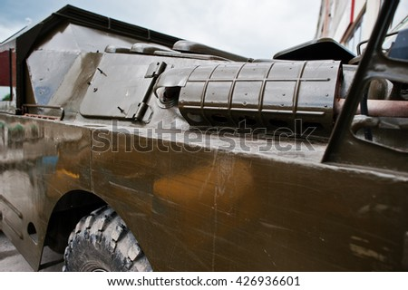 Podol, Ukraine - May 19, 2016: Close up exhaust on armored military car BDRM -2 - stock photo