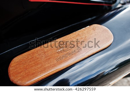 Podol, Ukraine - May 19, 2016: Logo on wood element of luxury retro car Maybach.