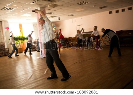PODPOROZHYE, RUSSIA - JULY 5: Day of Health in Center of social services for pensioners and the disabled Otrada (gymnastics for eldery and disabled), July 5, 2012 in Podporozhye, Russia. - stock photo