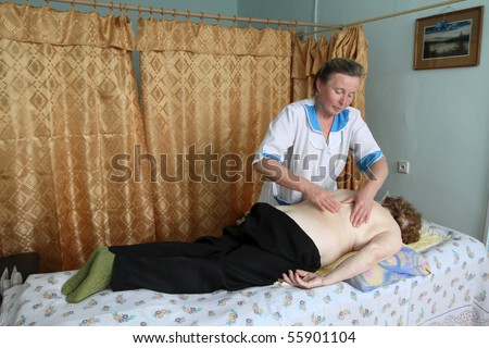 PODPOROZHYE, RUSSIA - JUNE 4: Day of Health in Center of social services for pensioners and the disabled Otrada (massage for the elderly), June 4, 2010 in Podporozhye, Russia. - stock photo