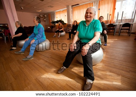 PODPOROZHYE, RUSSIA - MAY 4: Day of Health in Center of social services for pensioners and disabled Otrada (gymnastics with ball for eldery), May 4, 2012 in Podporozhye, Russia. - stock photo