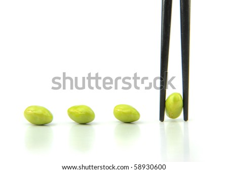 pods held by chopsticks - stock photo